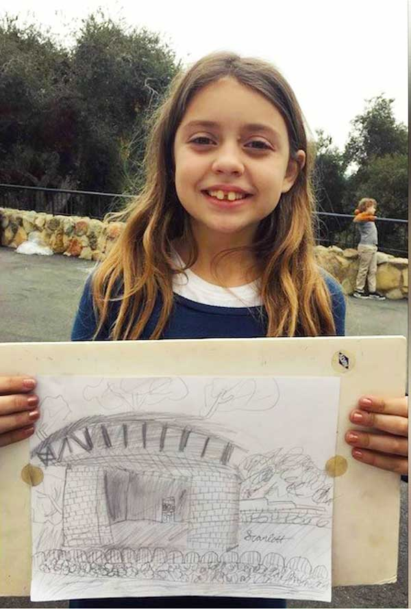 girl smiling with her architecture drawing